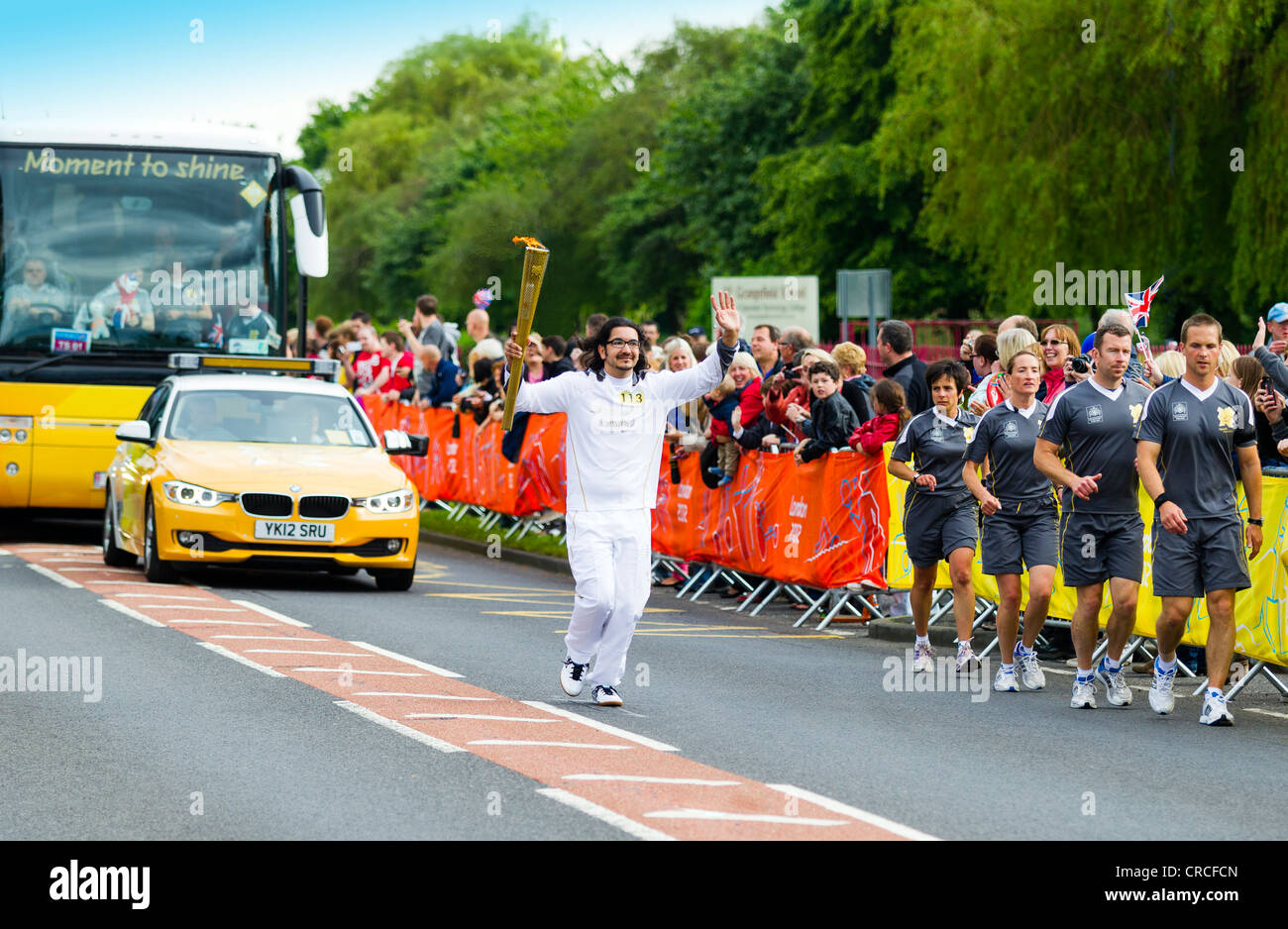 2012 Olympic Torch Relay team running through Stockton on Tees - Stock Image