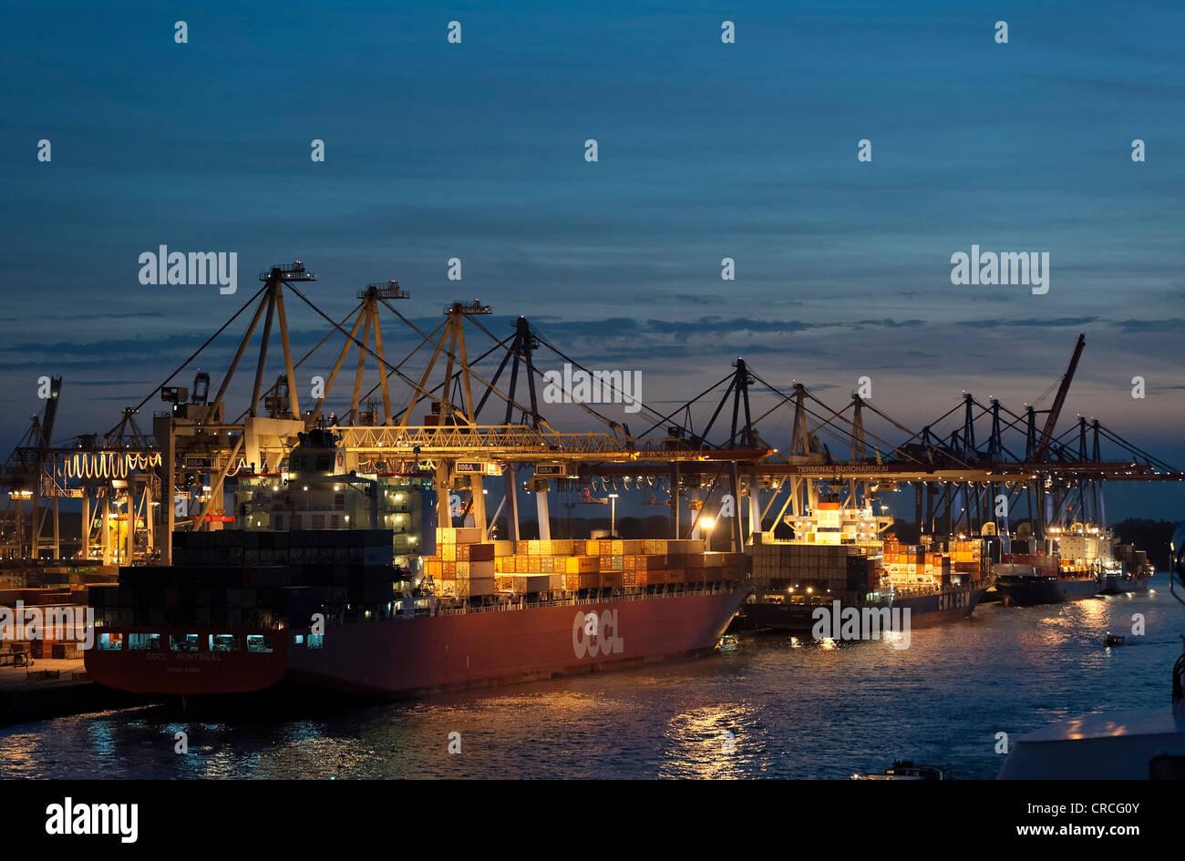Cargo vessel OOCL Montreal in the Freeport of Hamburg, Elbe river, Hamburg, Germany, Europe - Stock Image