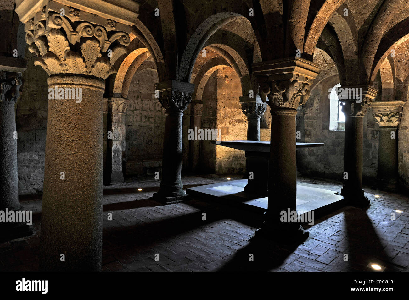 Altar in the underground pillared hall of the pagan crypt, 10th century, Cathedral of St. Sepulchre, Basilica Cattedrale - Stock Image