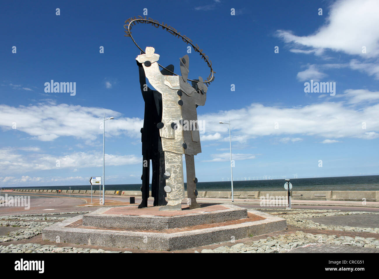 Metal clown statue welcoming people to New Brighton on the Wirral. - Stock Image