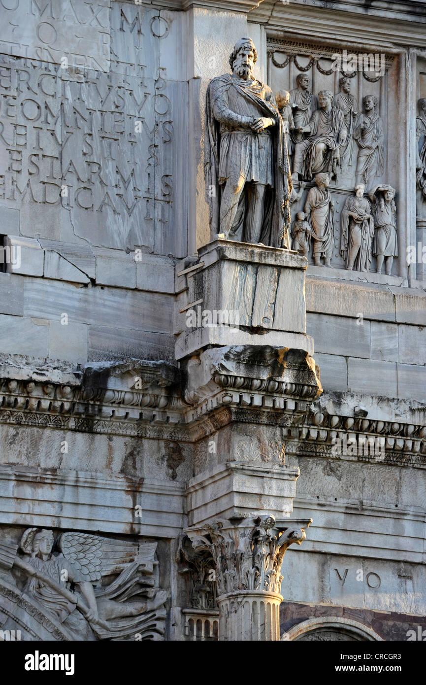 Statue of a Dacian prisoner with attic relief on the Arch of Constantine, Piazza del Colosseo, Rome, Lazio, Italy, - Stock Image