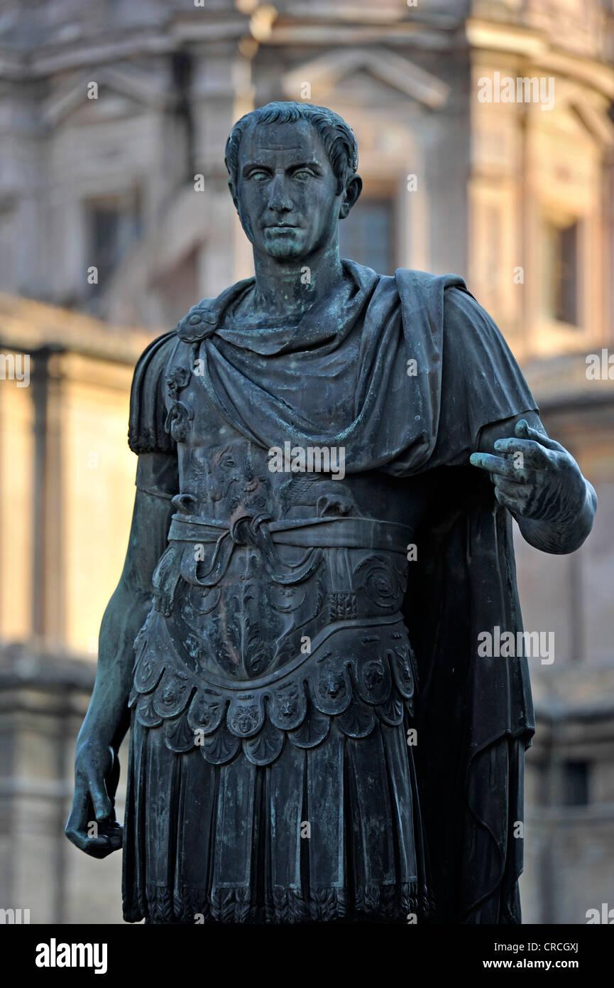 Bronze statue of the Roman Emperor Gaius Julius Caesar at Caesar's Forum, Via dei Fori Imperiali, Rome, Lazio, - Stock Image