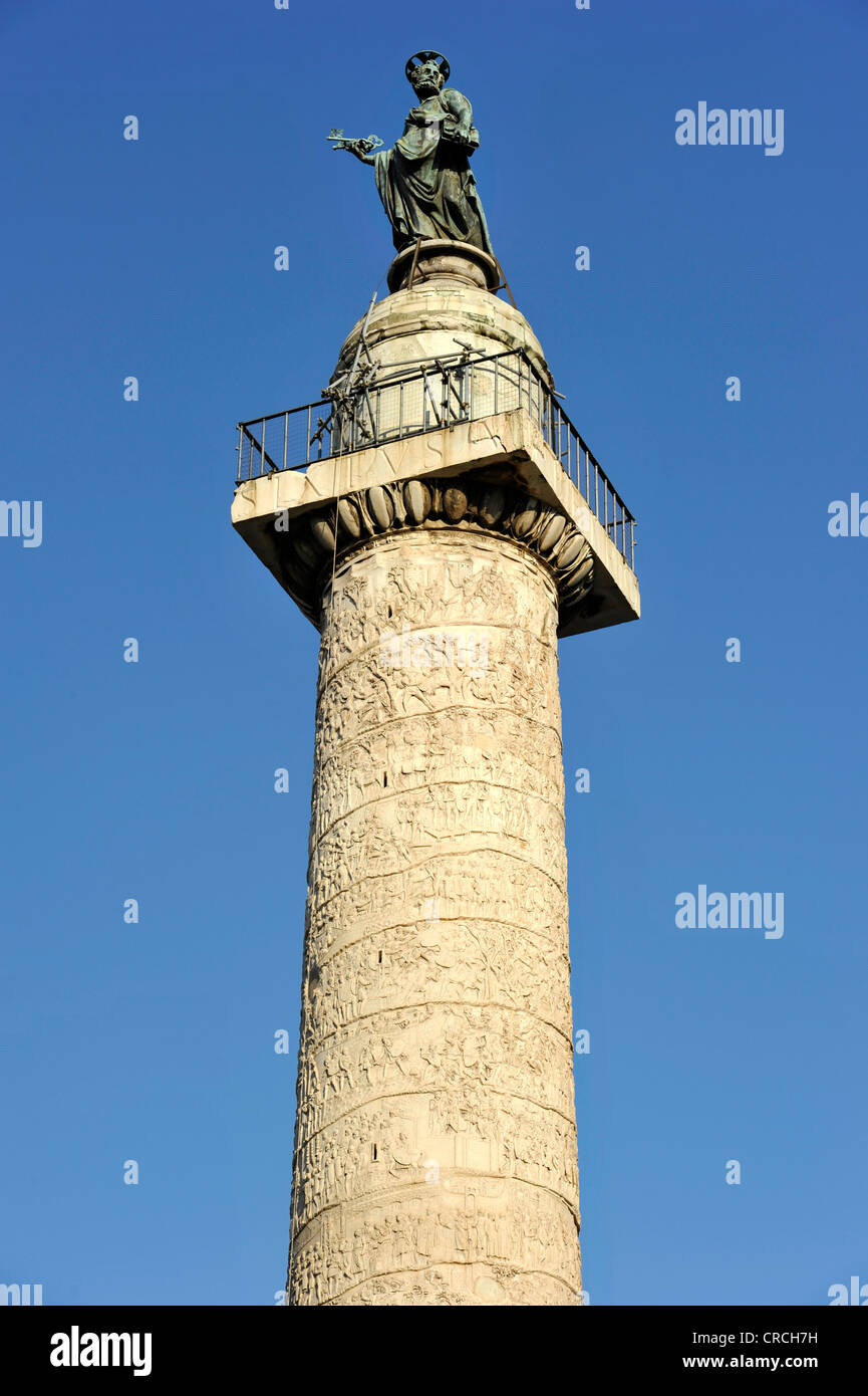 Trajan's Column with war depictions in relief band and with bronze statue of the apostle Peter, Trajan's - Stock Image