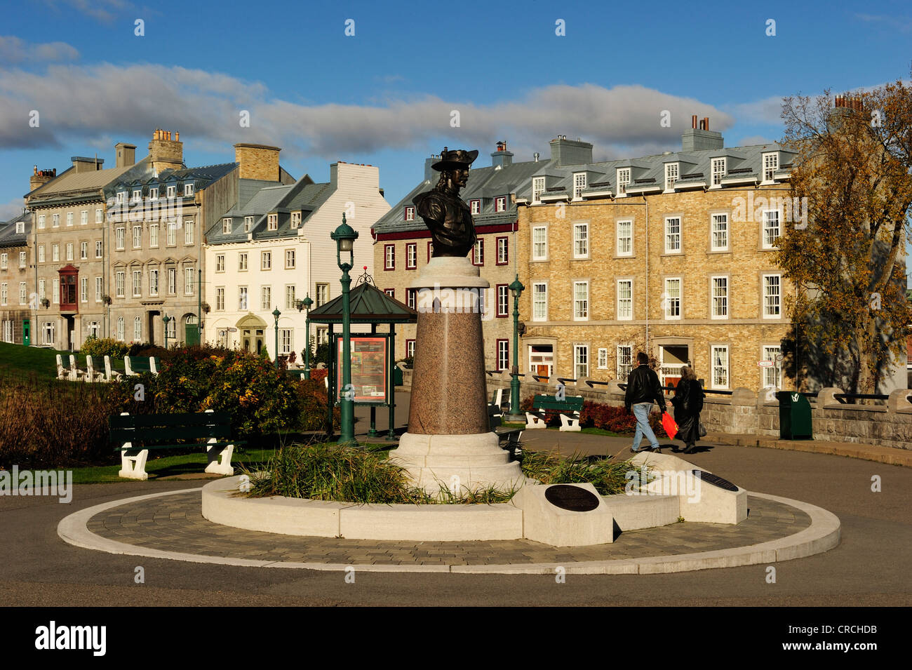 Statue of Pierre Dugua de Mons against the backdrop of the historic town centre of Quebec City, Quebec, Canada - Stock Image