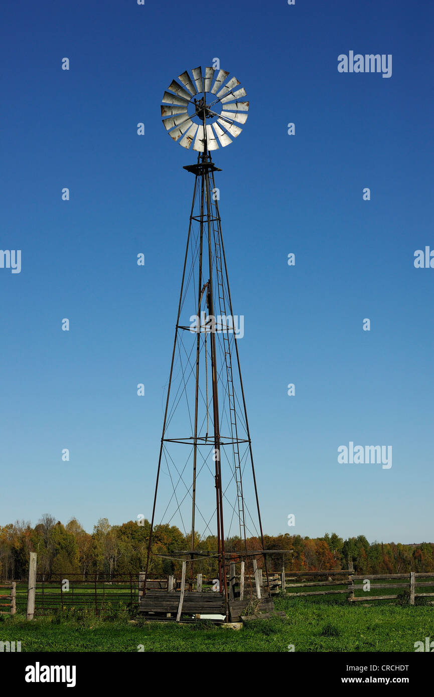 Windmill for pumping water from a bore, Lac du Cerf, Quebec, Canada - Stock Image