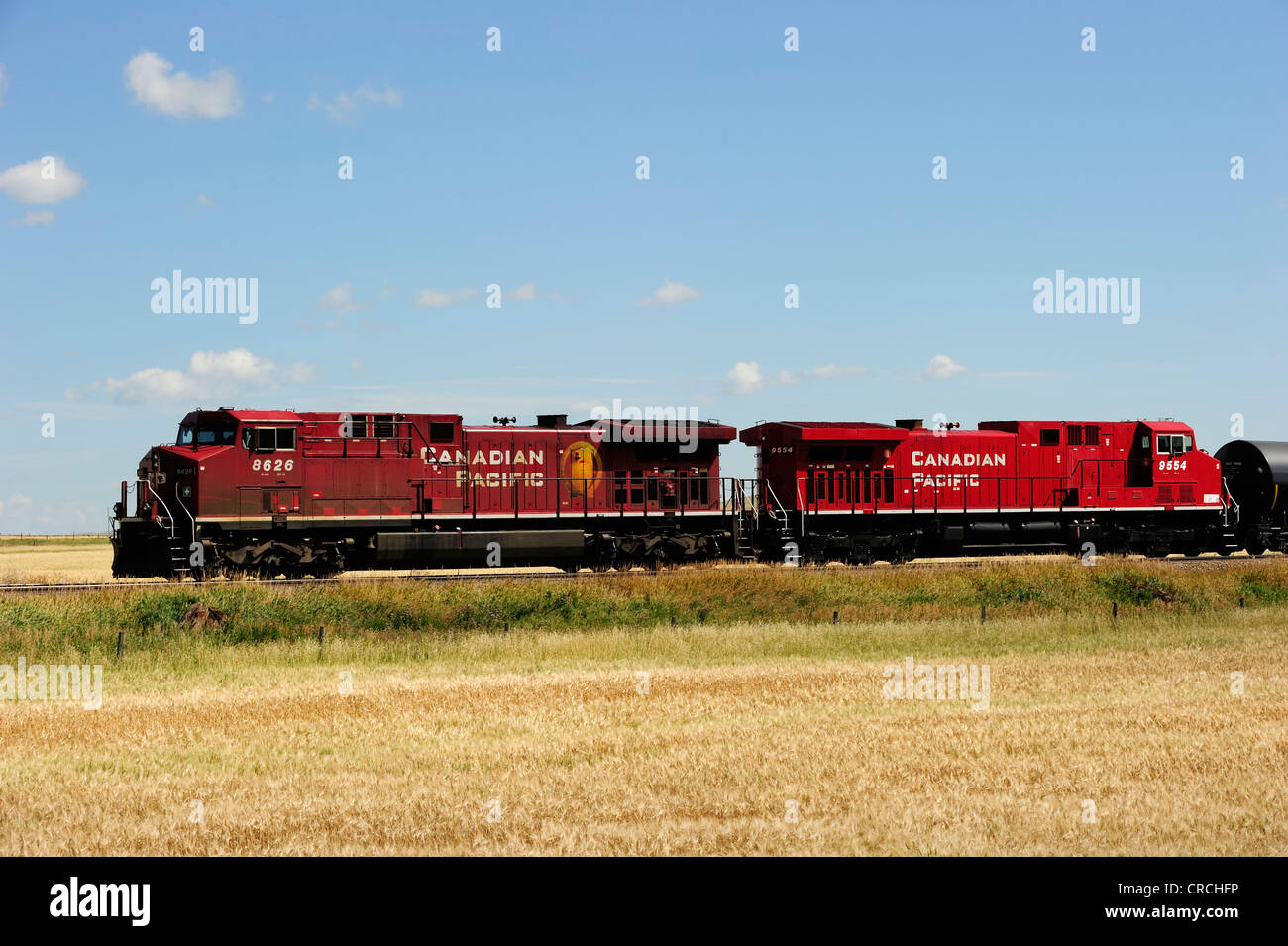 Two locomotives of the Canadian Pacific Railway in the prairie, Alberta, Canada - Stock Image