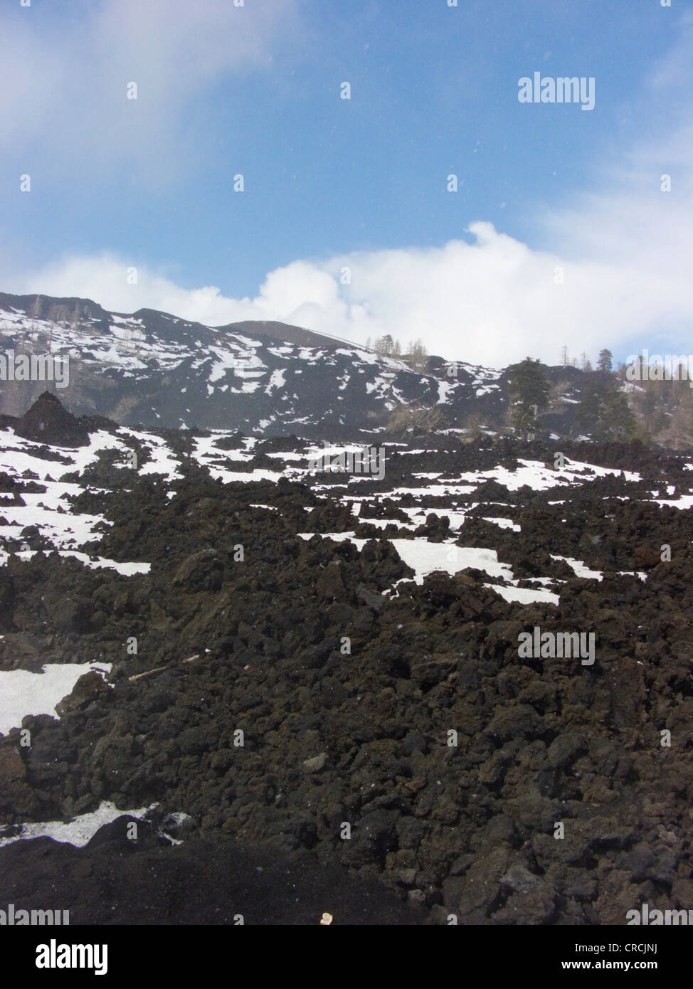 lava field with snow at the North of Mount Etna, Italy, Sicilia Stock Photo