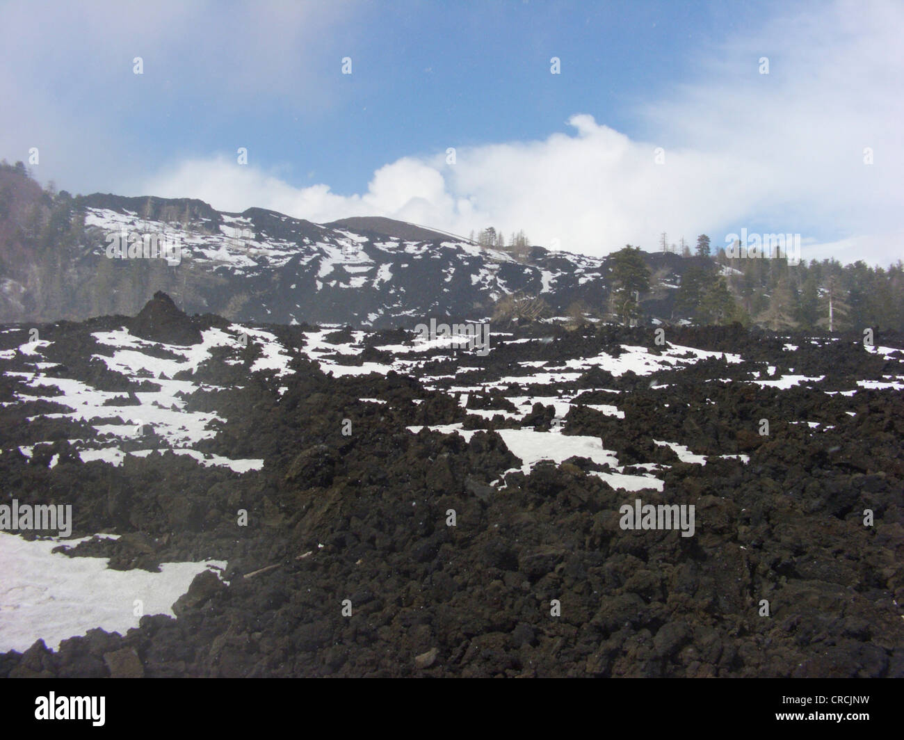 lava field with snow at the North of Mount Etna, Italy, Sicilia - Stock Image
