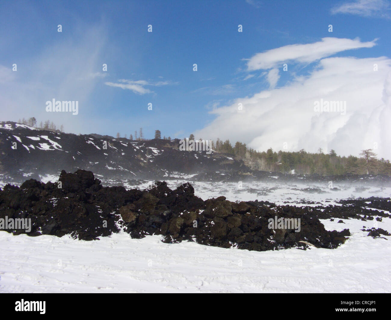 lava fields with snow at the North of Mount Etna at Monte Conca, Italy, Sicilia - Stock Image