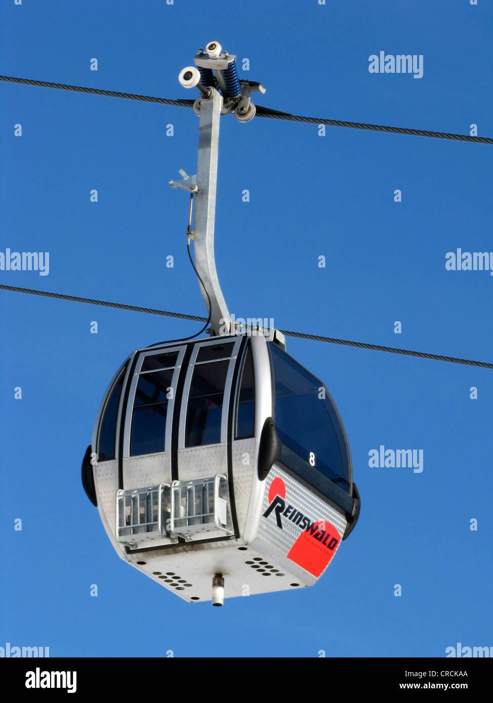 Gondola of gondola ski lift in a skiing area, Italy, Suedtirol, Sarntal, Sarentino, Reinswald - Stock Image