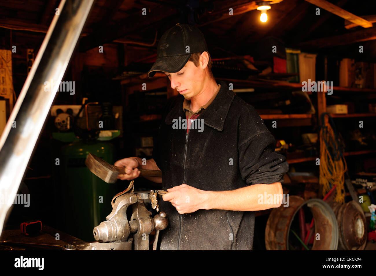 Man repairing spurs, Saskatchewan, Canada, North America - Stock Image