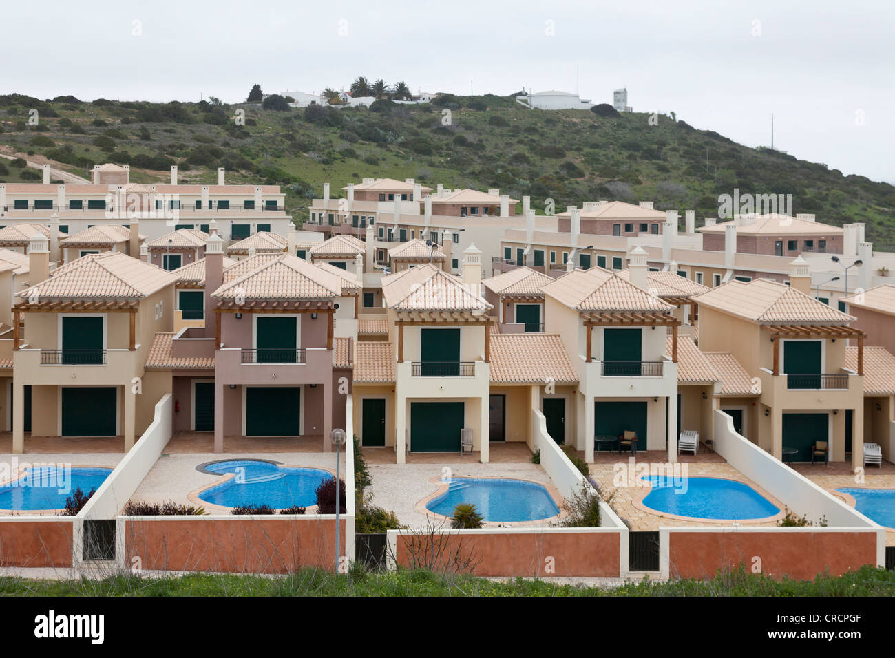 Monotone, uninhabited cottages, town houses with pools, Algarve, Portugal, Europe - Stock Image