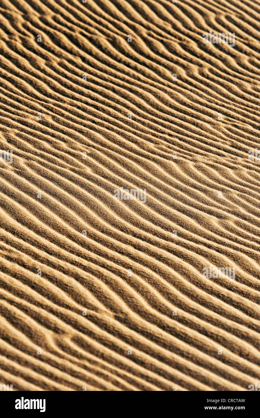Sand with shapes from the wind. - Stock Image