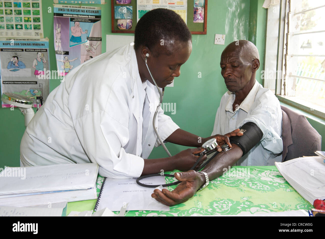 Doctor and patient in a hospital near Bukoba, Tanzania, Africa - Stock Image