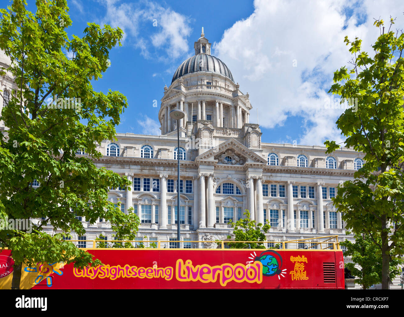 The Port of Liverpool Building with a red sightseeing tour bus outside Merseyside England uk gb eu europe - Stock Image