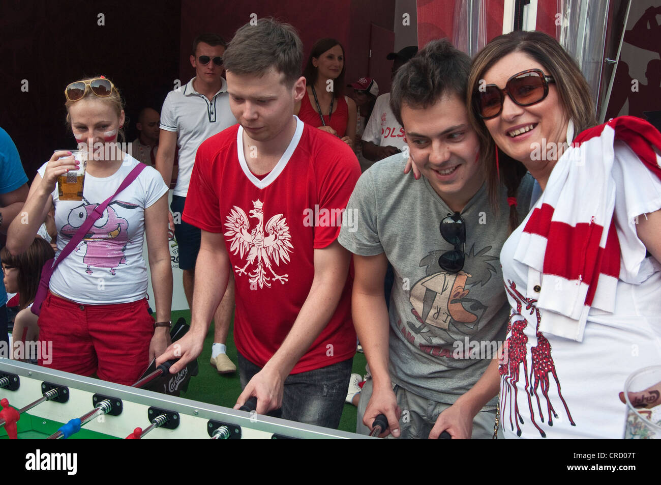 Soccer fans playing table football before watching match during EURO 2012 Football Championship at Fan Zone in Wrocław, - Stock Image