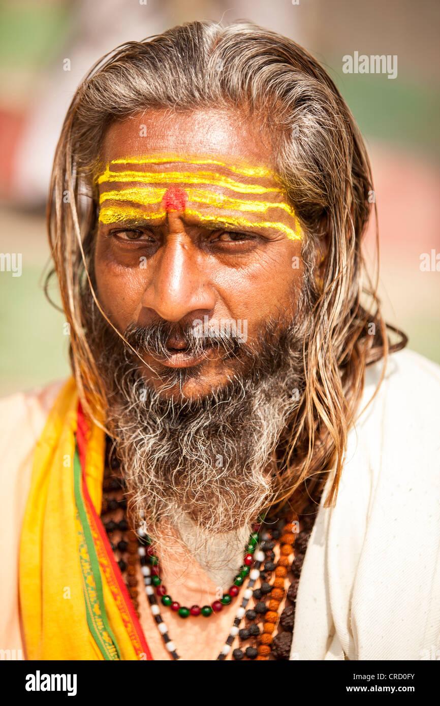 Sadhu (holy man) face in Varanasi, Uttar Pradesh, India - Stock Image
