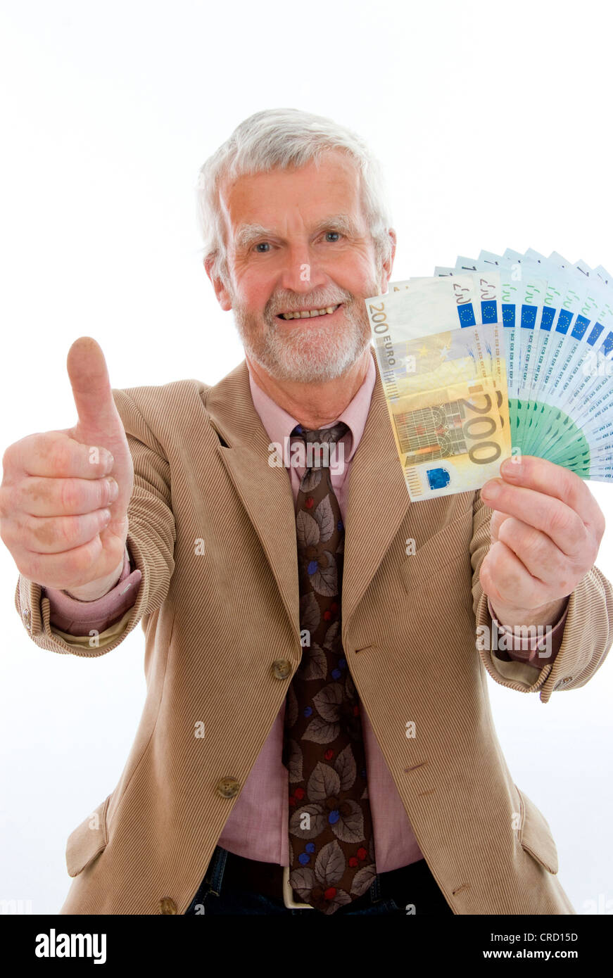 older, successful man with money - Stock Image