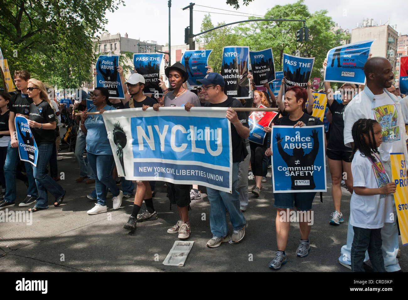 Thousands of demonstrators march down Fifth Avenue in New York for a silent march protesting the NYPD policy of - Stock Image