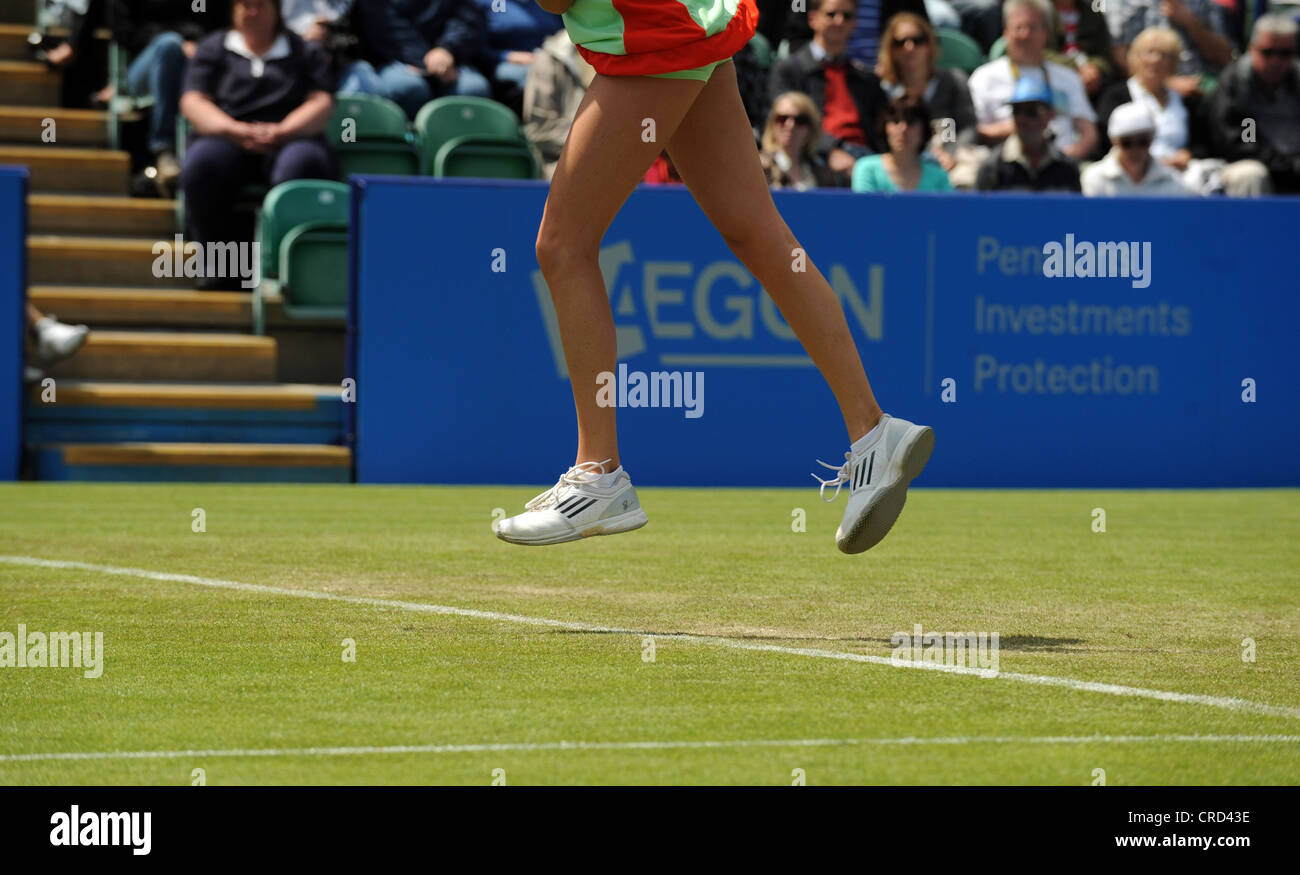 Tennis serve speed stock photos tennis serve speed stock images close up of female tennis players feet leaping in air while she hits a serve voltagebd Image collections