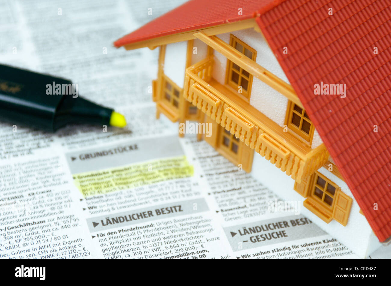 model of a house on a plot request - Stock Image