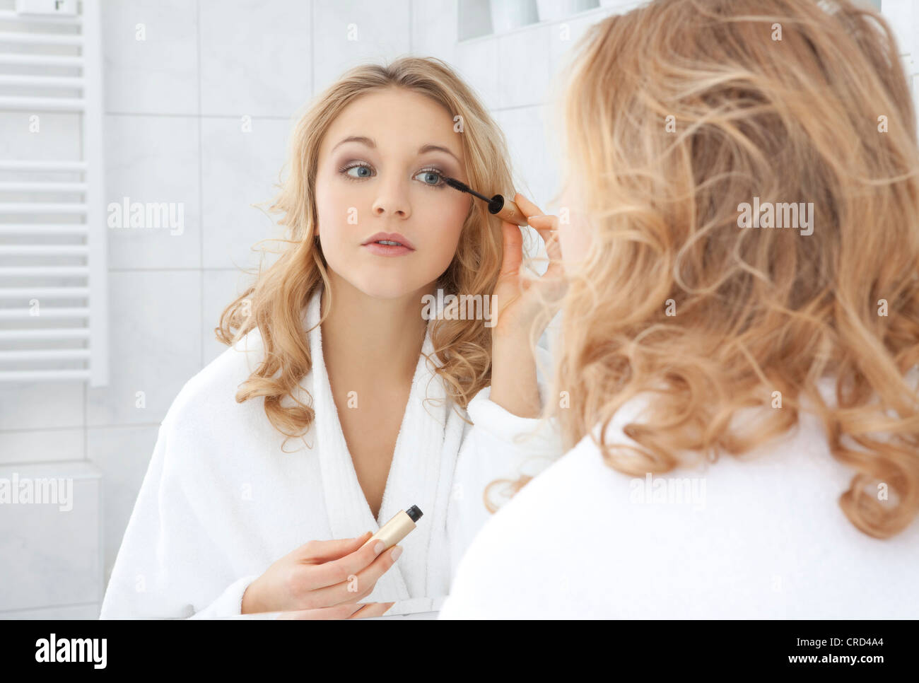 Young woman making up - Stock Image
