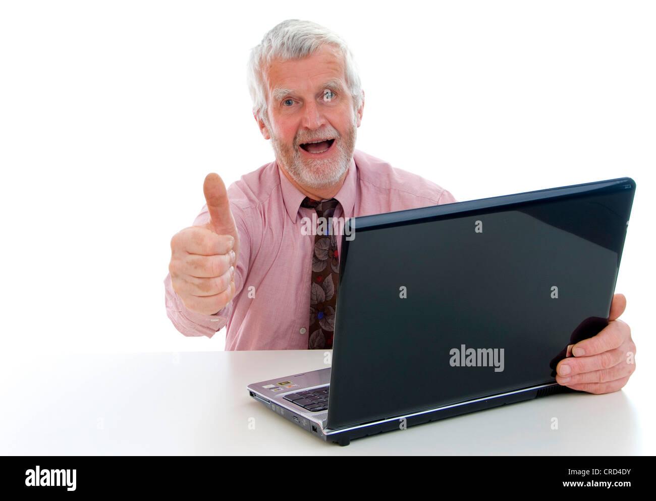 senior with laptop - Stock Image