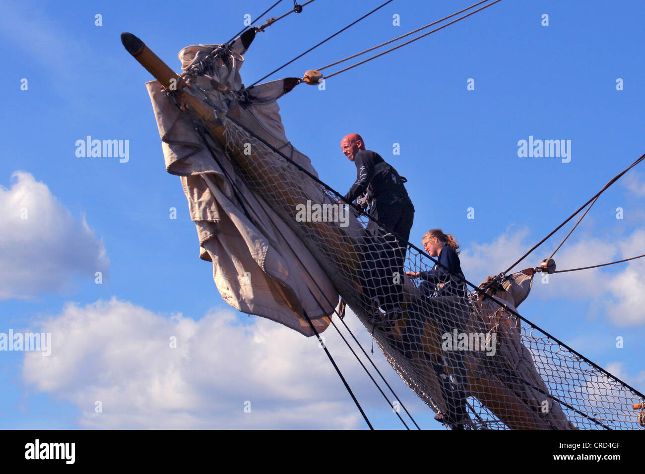 The Tall Ships' Races at Kotka. Crew on jibboom, Finland, Kotka - Stock Image
