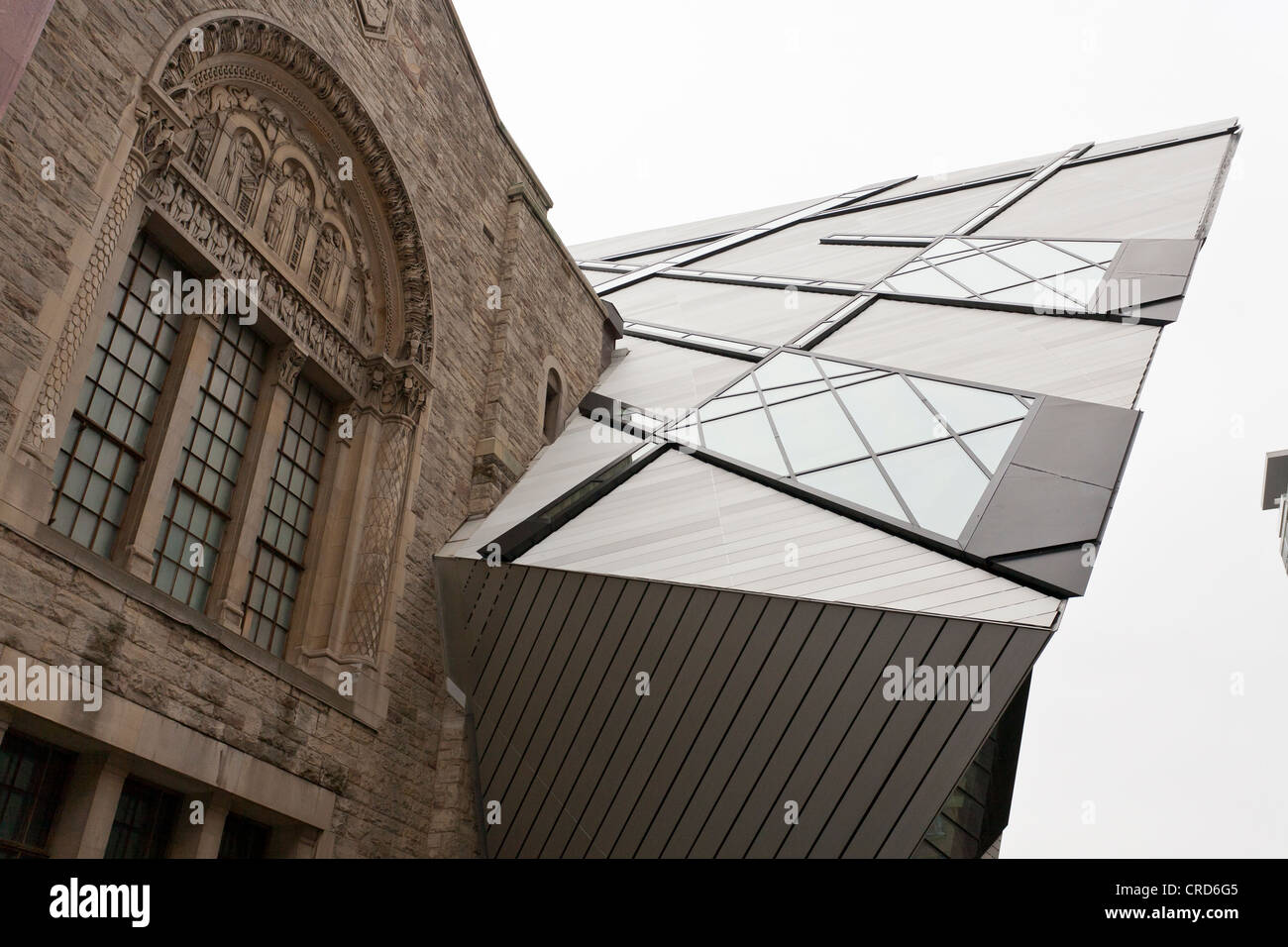 Crystal Encrustation. The crystal addition to the old stone museum building provides a contrast between the architectural - Stock Image
