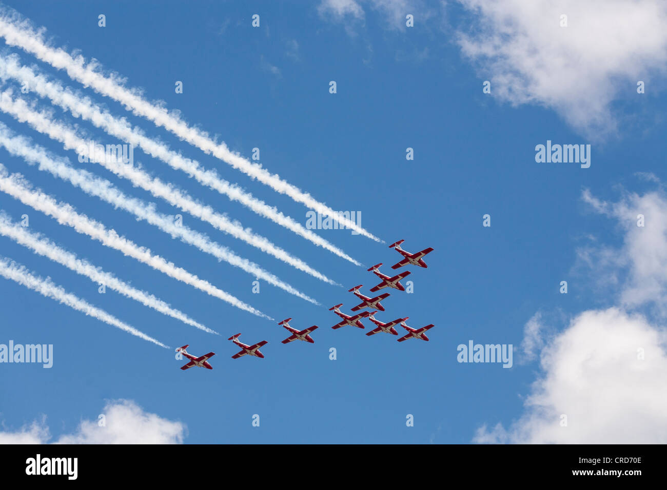 Snowbirds in Formation over Ottawa.  A formation of 9 Snowbird acrobatic training planes Canada day fly past parliament - Stock Image