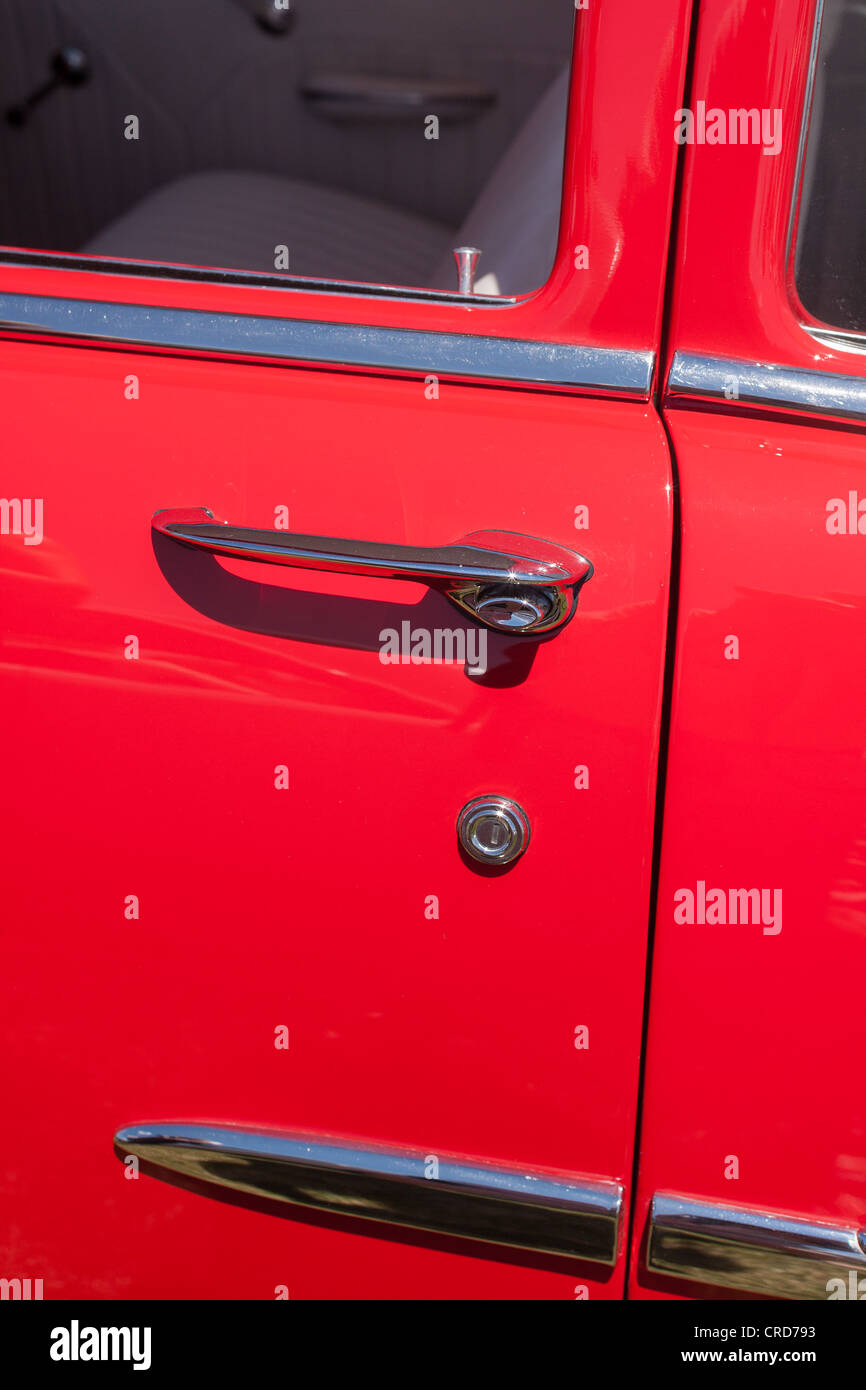 Door Detail from a red 1955 Chev. Door detail from a restored 1955 Chevrolet 210 Post automobile. - Stock Image