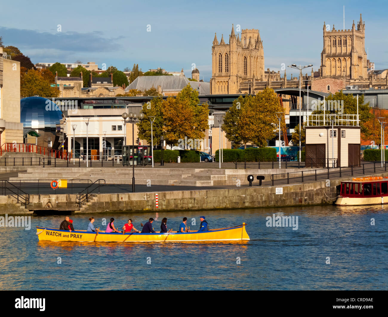 Rowing team in water at Bristol Docks and Harbour area in the city centre England UK which has been extensively - Stock Image