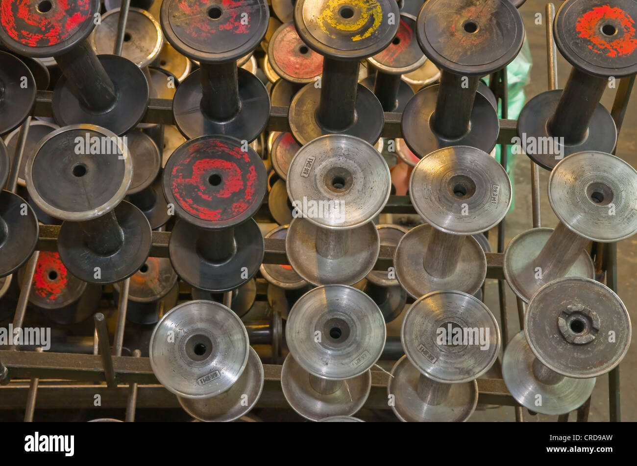 Textile factory equipment in the workshop - Stock Image