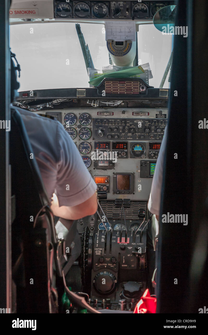 Beechcraft 1900D Cockpit from the passenger cabin. - Stock Image