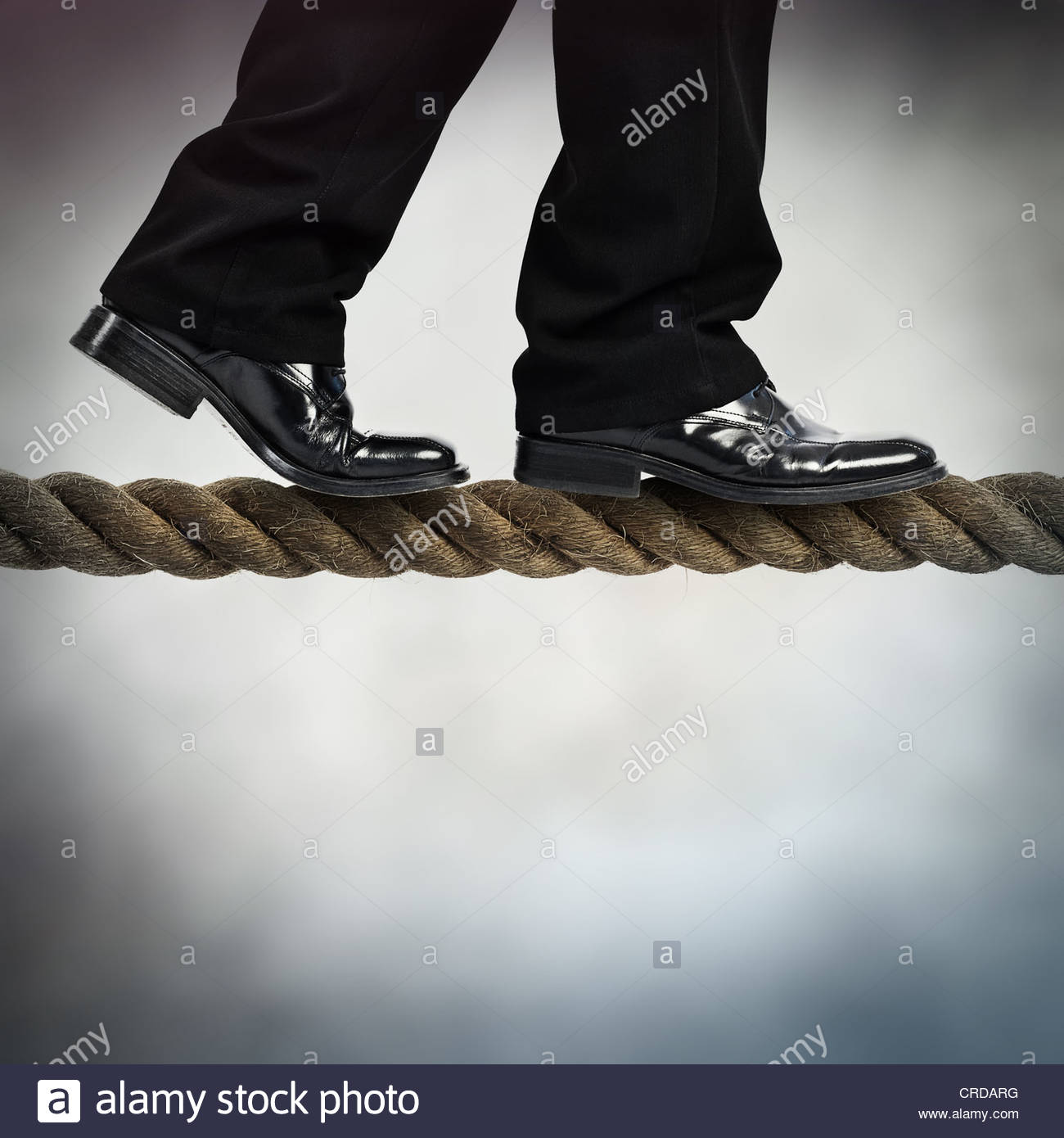tightrope walk - Stock Image