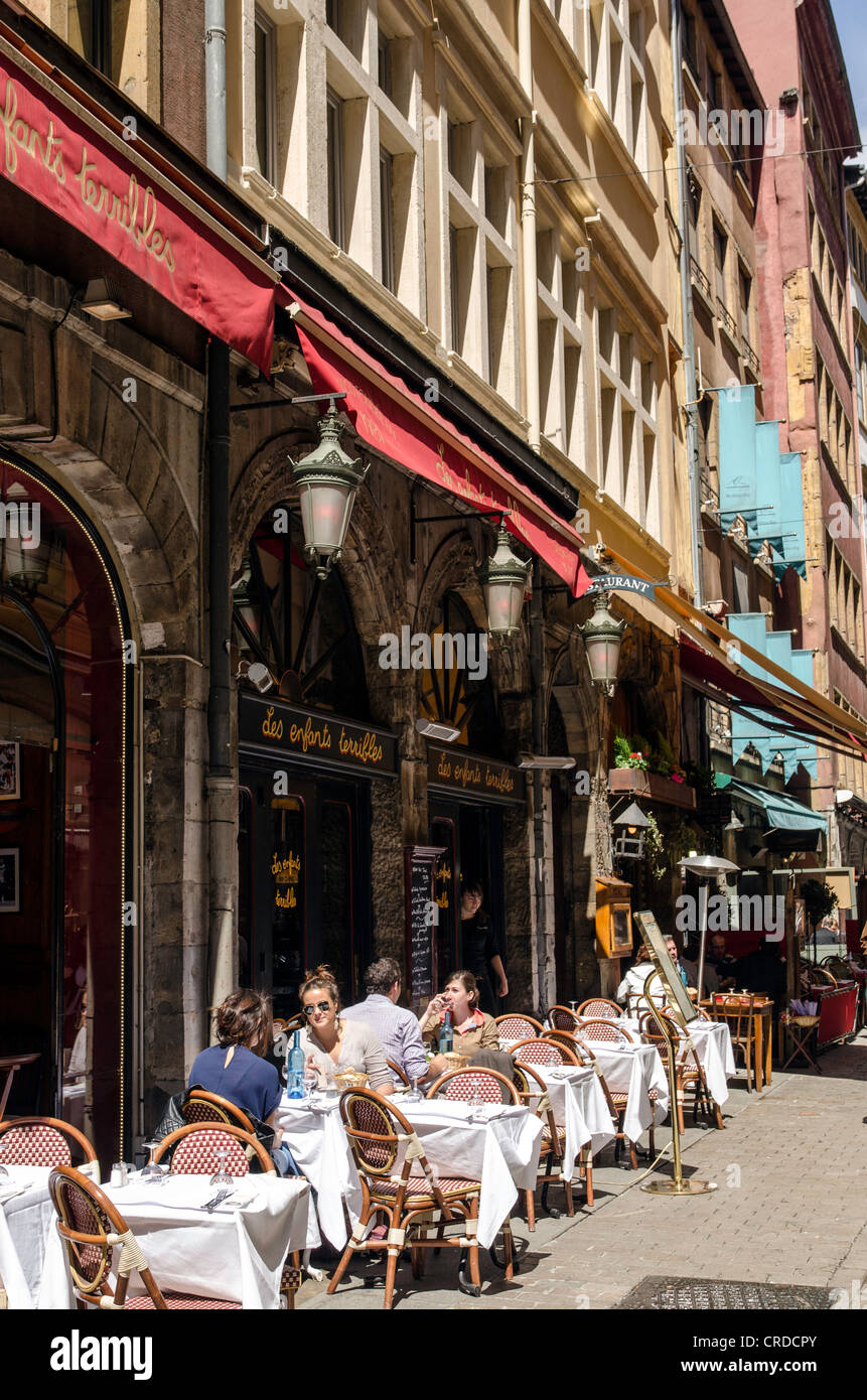 People enjoying the sun in an outdoor bar Lyon France Europe - Stock Image