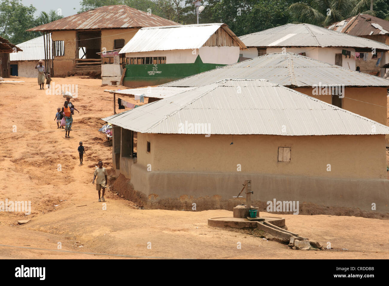 People walk through the village of Julijuah, Bomi county, Liberia on Tuesday April 3, 2012. - Stock Image