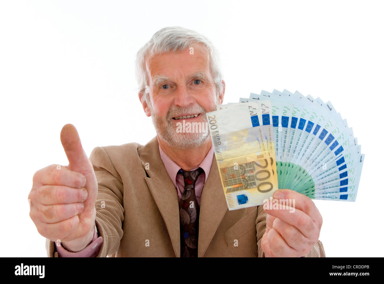 older, successful man with lots of banknotes in his hand - Stock Image