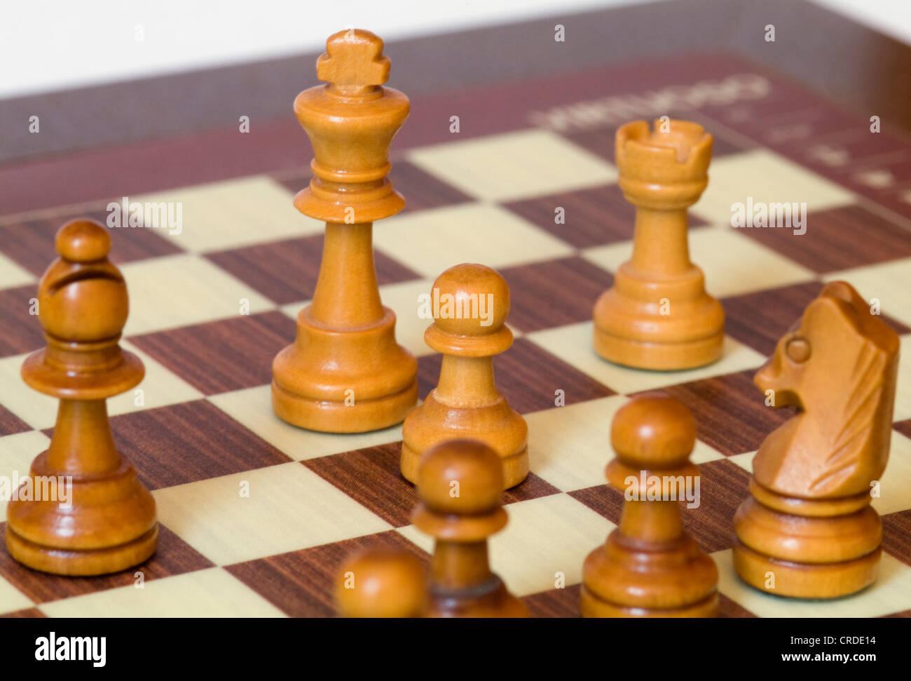chessmen on chessboard - Stock Photo