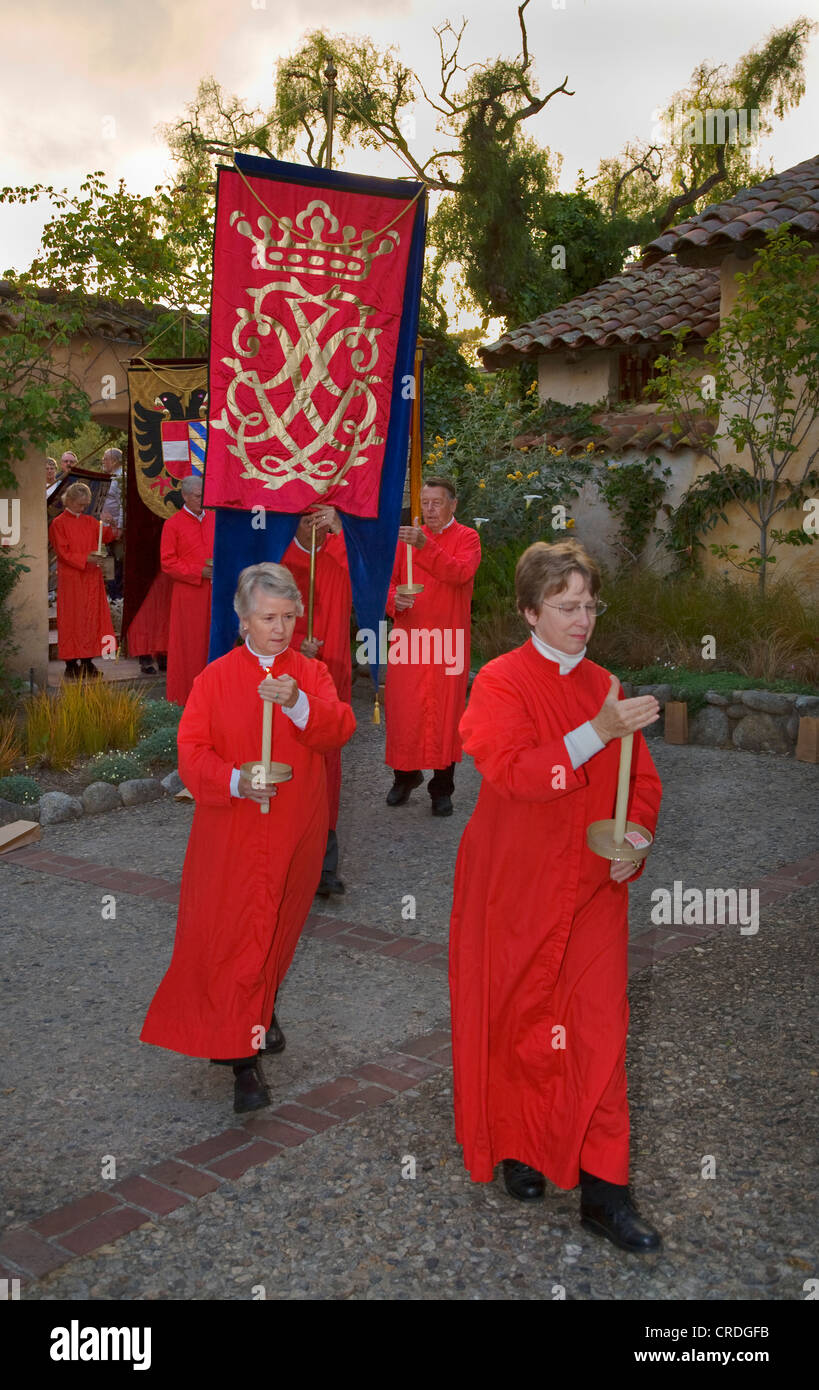 Church members carry banners reenacting the MEDIEVAL TRADITION during the CARMEL BACH FESTIVAL, USA, California, - Stock Image