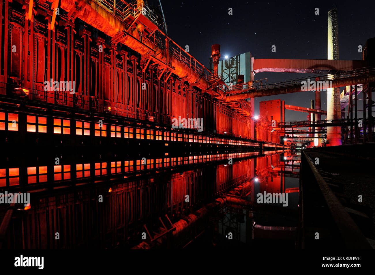 Industrial buildings illuminated at night, Zeche Zollverein Coal Mine, Essen, North Rhine-Westphalia, Germany, Europe - Stock Image