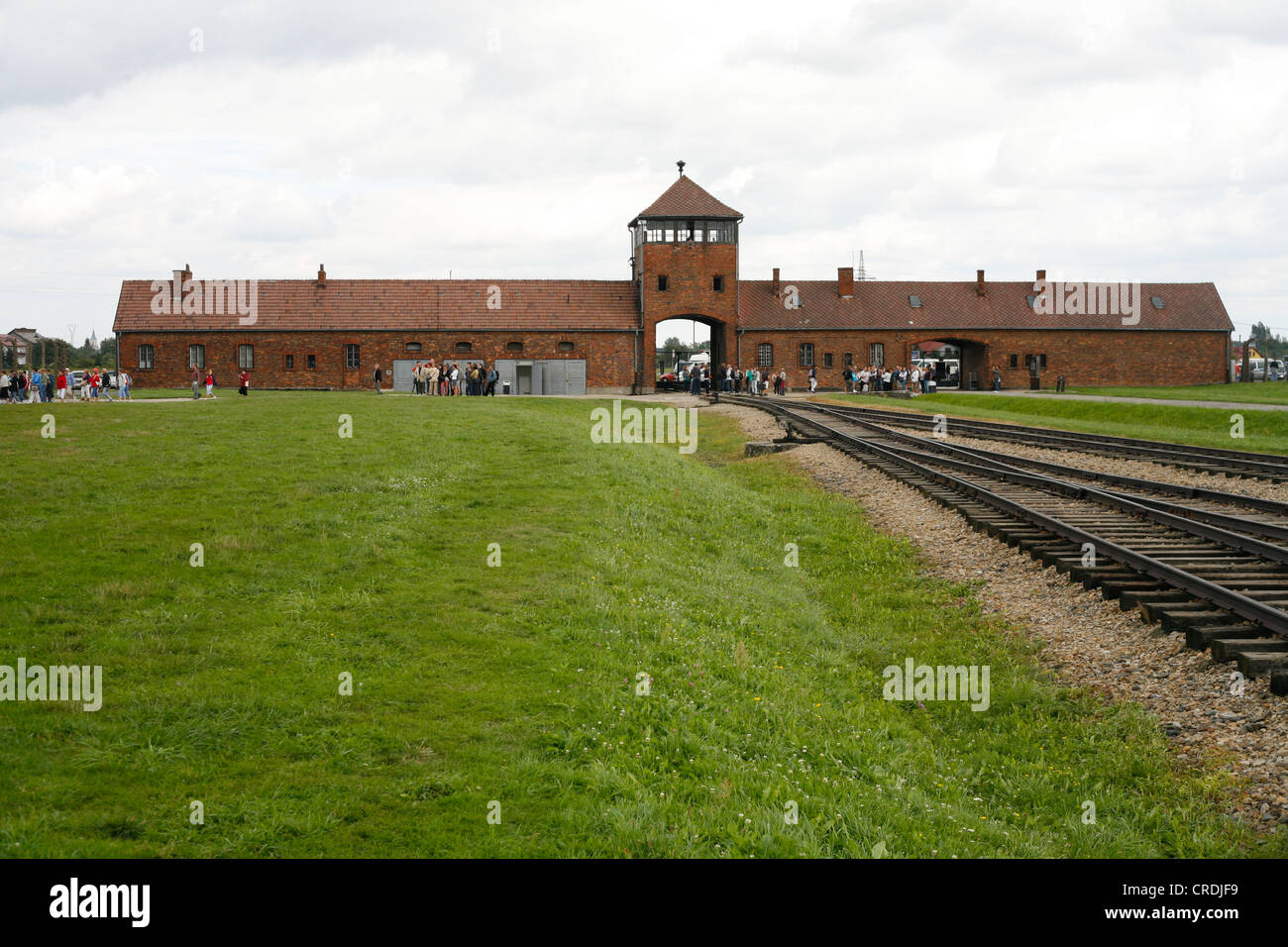 Entrance gate and rail tracks to the concentration camp, Auschwitz-Birkenau, Poland, Europe - Stock Image