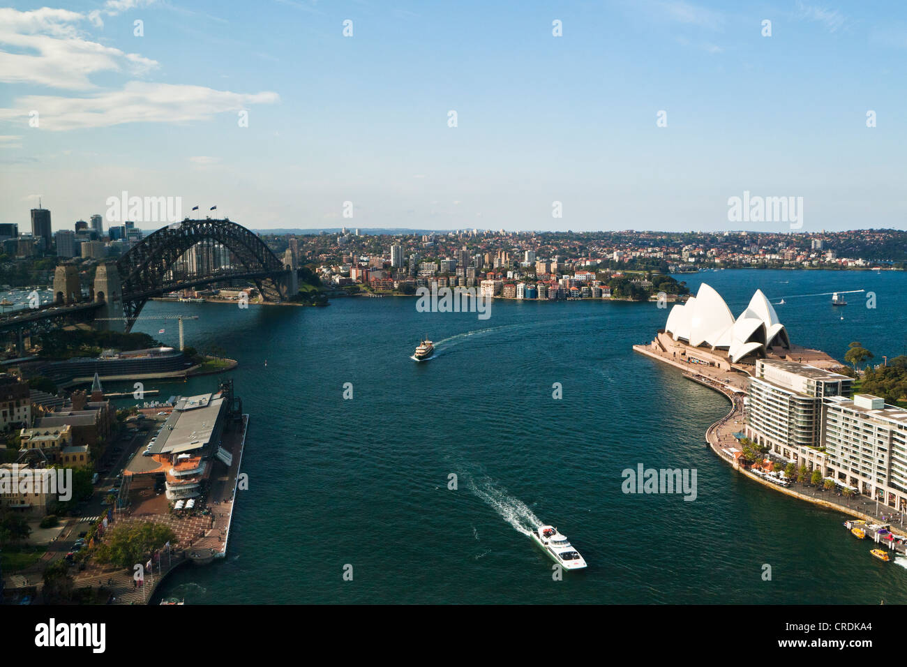 Sydney Cove, with the Opera House and Sydney Harbour Bridge in the harbour, Sydney, New South Wales, Australia - Stock Image