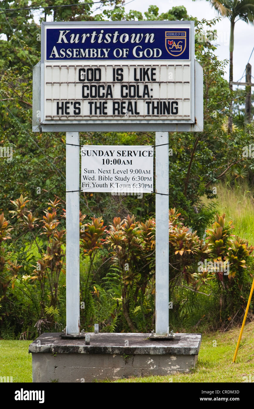 Church sign, God is like Coca Cola, He's the real thing, Kurtistown, Hawai'i, USA - Stock Image