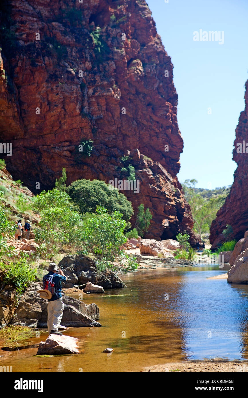 Man at the entrance to Simpsons Gap in the West MacDonnell Ranges - Stock Image