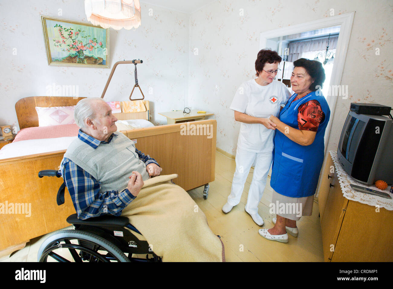 Outpatient care provided by the German Red Cross, nurse Anke Lehmann visits an elderly couple every morning to help - Stock Image