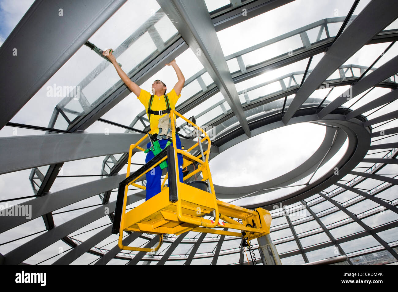 Window cleaner cleaning the dome of the Reichstag Building, Deutscher Bundestag, German parliament, Berlin, Germany, - Stock Image