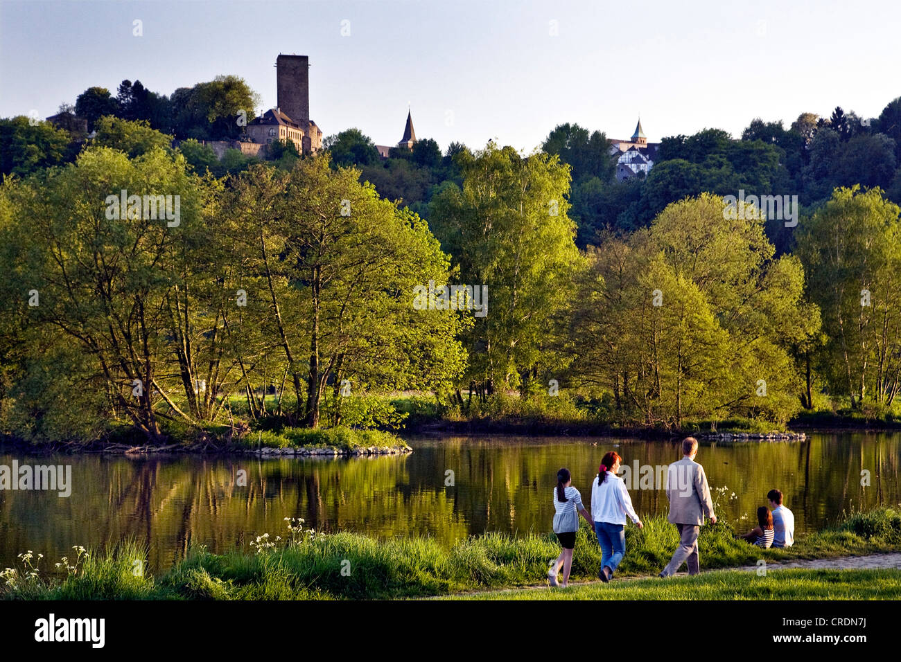 family near the Ruhr river looking towards Hattingen Blankenstein Castle, Germany, North Rhine-Westphalia, Ruhr Stock Photo