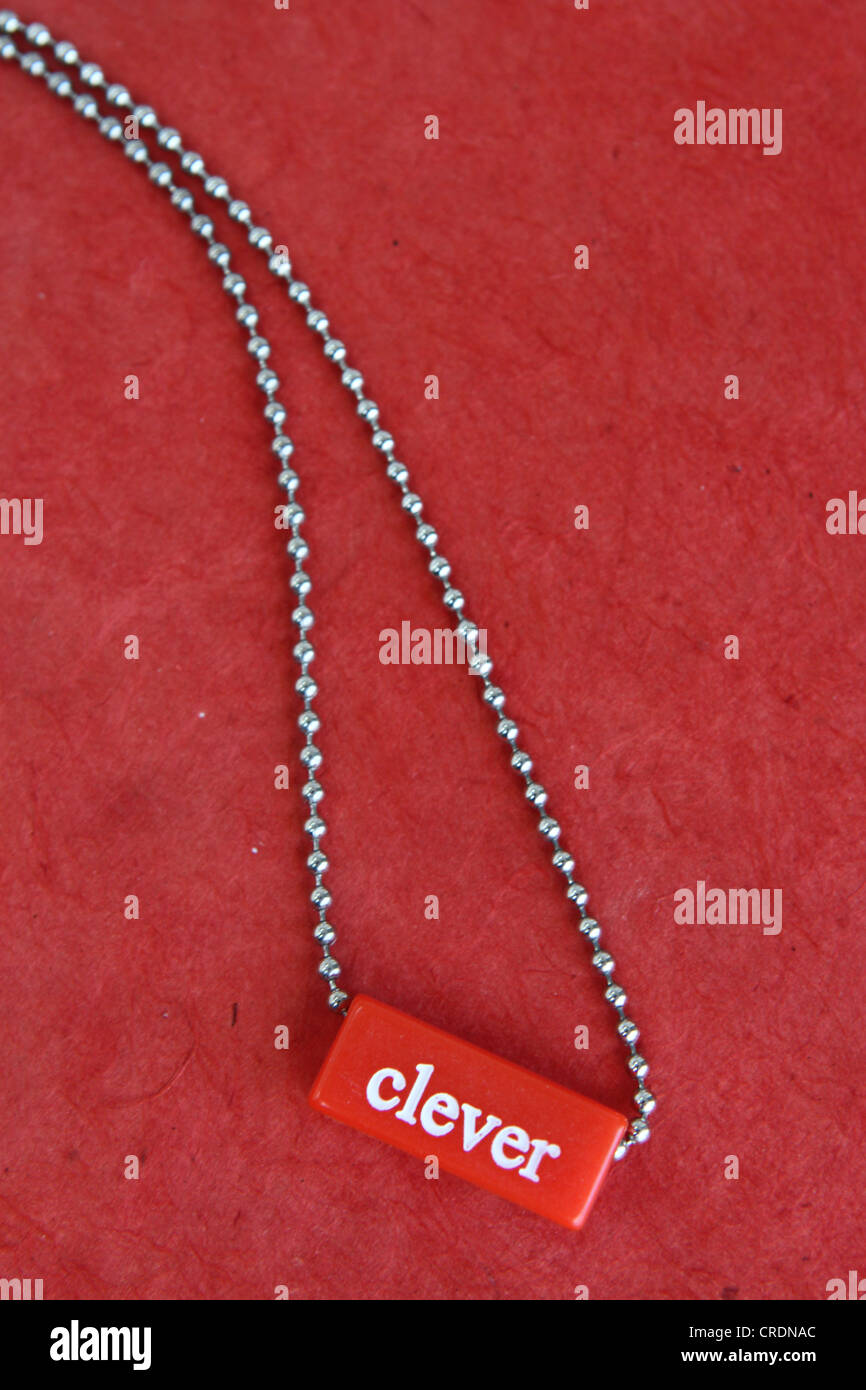 The word 'clever' on a necklace. - Stock Image