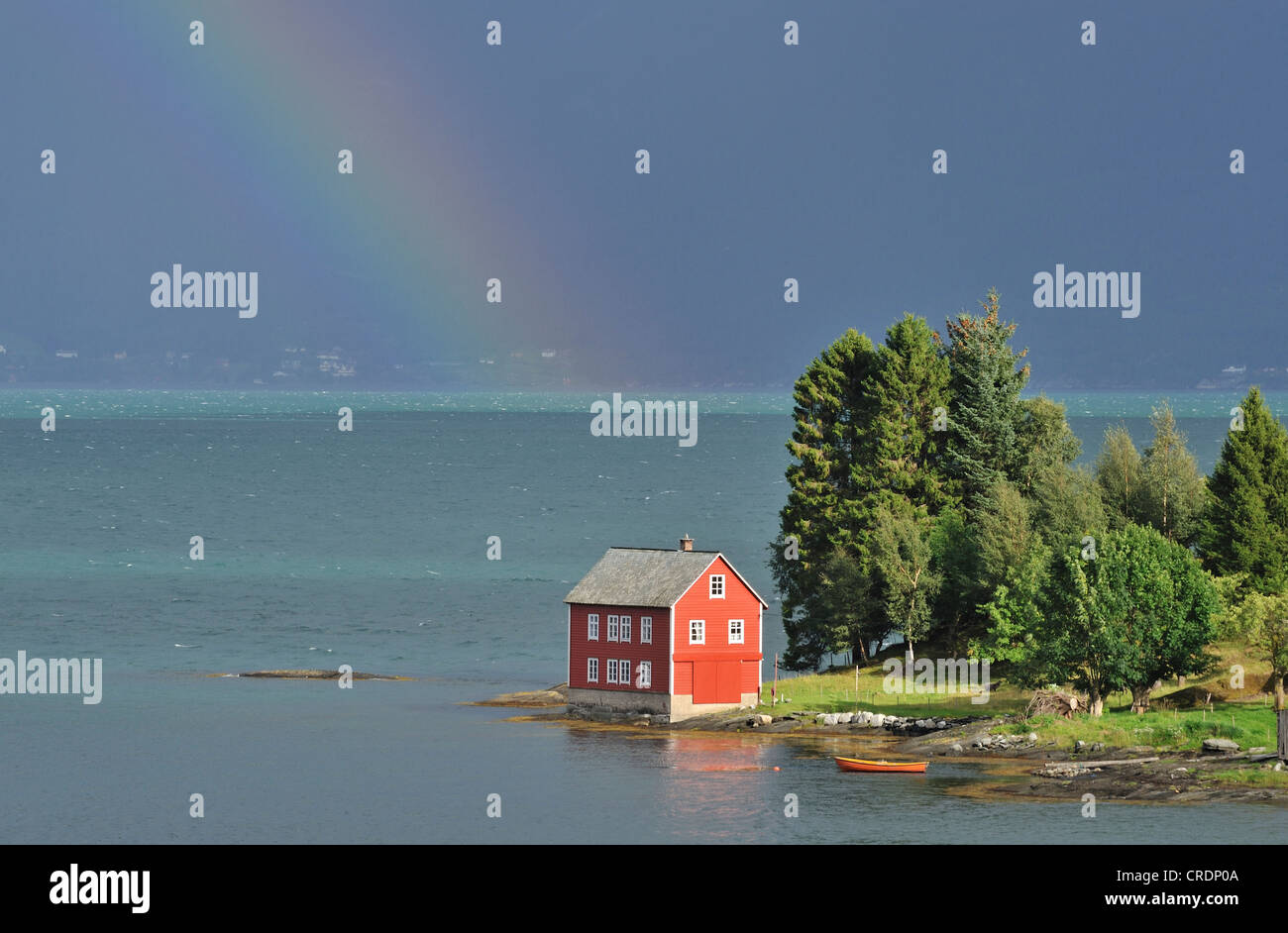Wooden house on a small island in Hardanger Fjord, Oma, Norway - Stock Image